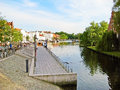 Luebeck river trave germany may promenade of in the historic city district altstadt quay wall in front near landmark holstentor Stock Photos