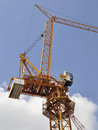 Luffing jib tower crane against blue sky Stock Photography