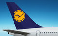 Lufthansa german airlines logo plane airplane of with the on tail is close up on beautiful blue sky background the sky area is Stock Photos