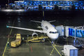 Lufthansa jet at night airbus a parked the gate munich international airport Stock Photo