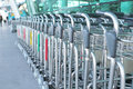 Luggage carts at an international airport entrance Royalty Free Stock Photos
