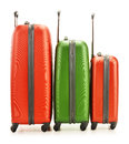 Luggage consisting of three polycarbonate suitcases on white background Stock Photos