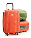 Luggage consisting of three polycarbonate suitcases on white background Stock Photography