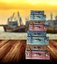 Luggage for travel on wooden floor beside the jetty Royalty Free Stock Photo