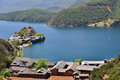 Lugu lake the women s kingdom lies kilometers from center of lijiang city on border between ninglang county in yunnan province and Stock Photos
