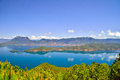 Lugu lake the women s kingdom lies kilometers from center of lijiang city on border between ninglang county in yunnan province and Royalty Free Stock Photo