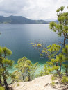 Lugu lake in yunnan china pine trees surround the view of province Stock Photos