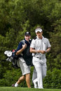 Luke Donald and Caddy - NGC2009 Stock Image
