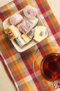 Lukum assort and tea turkish delight a cup of Stock Photography