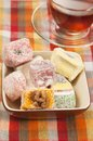 Lukum assort and tea turkish delight a cup of Royalty Free Stock Photos