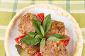 Lula lamb and tomato on a plate on the table Stock Photo