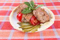 Lula lamb and tomato on a plate on the table Royalty Free Stock Photo