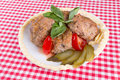 Lula lamb and tomato on a plate on the table tablecloth Stock Photo