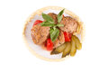 Lula lamb and tomato on a plate white background Royalty Free Stock Image
