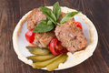 Lula lamb and tomatoes on a plate Stock Photography
