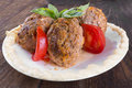 Lula lamb and tomatoes on a plate tomato the table Royalty Free Stock Photos
