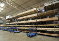 Lumber interior warehouse commercial indoor lumberyard with carts in front of Stock Photo