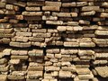 Lumber wood stacked in a pile background Stock Images
