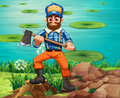 A lumberjack holding an axe at the riverbank Stock Image