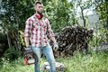 Lumberjack or woodcutter moving and looking with chainsaw for trees to chop Stock Photography