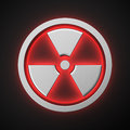 Luminous radiation symbol with backlight effect on the black background Stock Photos