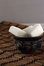Lump sugar in a bowl with oriental ornament Royalty Free Stock Images