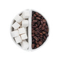 Lump sugar and coffee beans in a ceramic bowl isolated on white background Stock Image