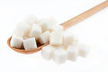 Lump sugar is in a wooden spoon Stock Photo