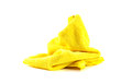 Lump yellow towel on a white background Stock Photo