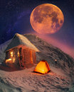 Lunar landscape on winter goverle incredible moon over mount goverla is a climber s dream that dream of him again and again snowy Stock Photo