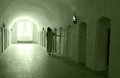 Lunatic asylum mentally ill woman walking down the corridor in a mental institution Royalty Free Stock Photos