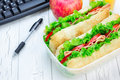 Lunch box with ciabatta bread sandwiches on workplace Royalty Free Stock Photo