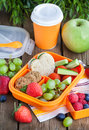 Lunch box with sandwich, cookies, veggies and fruits Royalty Free Stock Photo