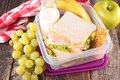 Lunch box school with sandwich Stock Images