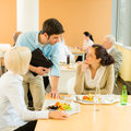 Lunch break office colleagues eat salad cafeteria Royalty Free Stock Photo