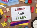 Lunch and learn sign with office stationery Royalty Free Stock Photo