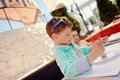 Lunch in a restaurant stylish little boy with sunglasses sitting at table Stock Image
