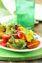 Lunch salad with arugula and tomatoes Royalty Free Stock Photo