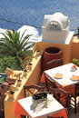 Lunch in santorini restaurant tables on a terrace overlooking sea island greece Stock Images