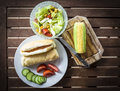 Lunch time saturday nice salads with corn on the cob and hot dogs Royalty Free Stock Images