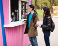 Lunch time. Young couple buying coffee Royalty Free Stock Photo