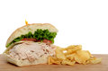 Lunch turkey sandwich with potato chips isolated white background Royalty Free Stock Photography