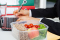 Lunchbox at work box with healthy food placed on the office desk Royalty Free Stock Images