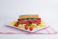 Luncheon sandwich with potato chips and cherry tomatoes and cucumber isolated on white background Royalty Free Stock Image