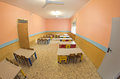 Lunchroom of the refectory of the kindergarten with small benche benches and chairs Royalty Free Stock Photos