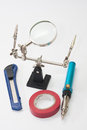 Lupa gas soldering iron scalpel and insulating tape Royalty Free Stock Photography