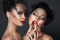 Lure. Two seductive Women with Cherry Berries Royalty Free Stock Photo