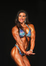 Luscious brunette bodybuilder displays glowing physique luann van akin arndt dazzles as she competes in the women s competition Stock Image