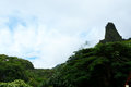 Lush emerald peak named the iao needle in iao valley state park west maui hawaii usa Stock Image