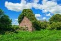 Lush green coutryside old stone structure ruined Stock Photos
